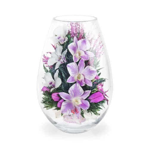 Бело-розовые и белые орхидеи с диантусами в средней каплевидной вазе