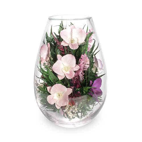 Фиолетовые и сиреневые орхидеи в средней каплевидной вазе